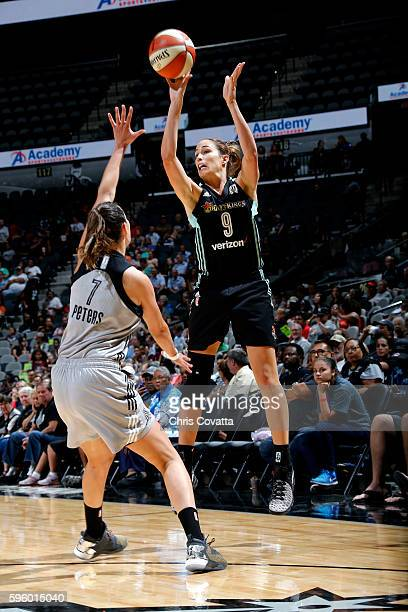 Rebecca Allen of the New York Liberty shoots the ball during the game against Haley Peters of the San Antonio Stars during the WNBA game on August 26...