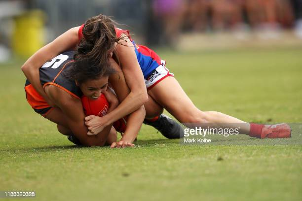 Rebecca Beeson of the Giants is tackled Lily Mithen of the Demons during the round five AFLW match between the Greater Western Sydney Giants and the...