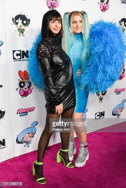 Rebecca Black and Meghan Trainor attend Christian Cowan x Powerpuff Girls Runway Show on March 08, 2020 in Hollywood, California.