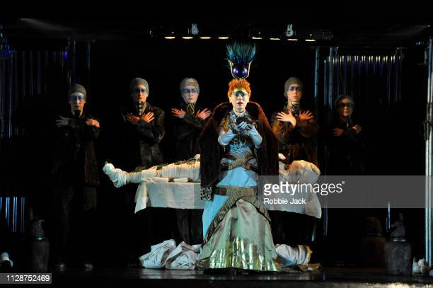 Rebecca Bottone as Queen Tye with artists of the company in English National Opera's production of Philip Glass's Akhnaten directed by Phelim...
