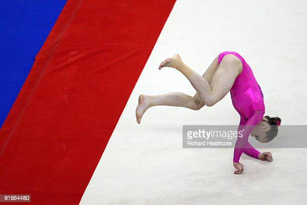 Rebecca Bross of USA falls as she competes in the floor exercise during the Women's All Round Final on the fourth day of the Artistic Gymnastics...