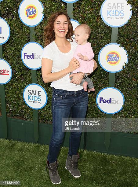 Rebecca Budig and daughter Charlotte Jo Benson attend the Safe Kids Day presented by Nationwide on April 26 2015 in West Hollywood California