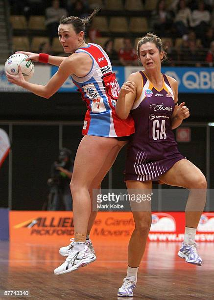 Rebecca Bulley of the Swifts secures the ball under pressure from Janelle Lawson of the Firebirds during the round seven ANZ Championships match...
