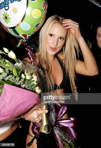 Rebecca Clare holds her prize after she is named as the overall winner for the Gridmodels 2006 Calendar Catwalk Competition at The Penthouse on...