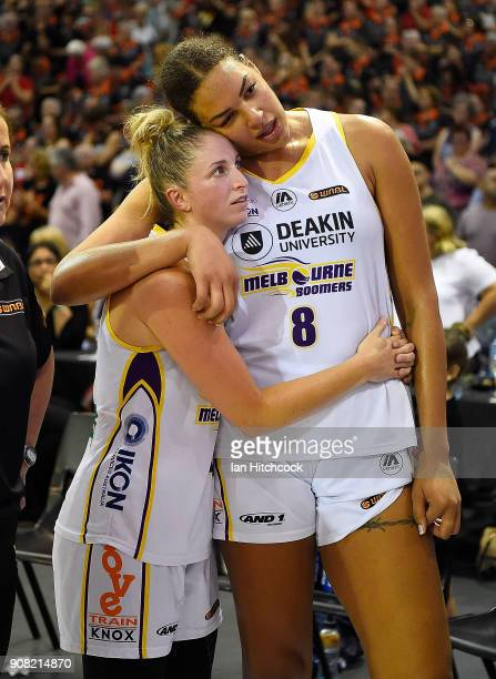 Rebecca Cole and Liz Cabbage of the Boomers console each other after losing game three of the WNBL Grand Final series between the Townsville Fire and...