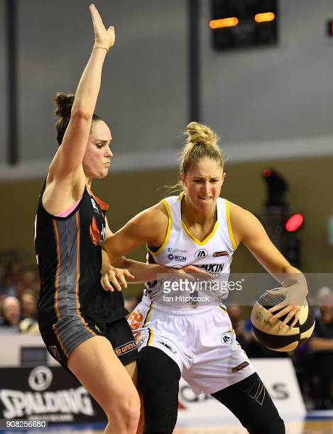 Rebecca Cole of the Boomers looks to get past Kelly Wilson of the Fire during game three of the WNBL Grand Final series between the Townsville Fire...