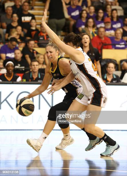 Rebecca Cole of the Melbourne Boomers is challenged by Kelly Wilson of the Townsville Fire during game two of the WNBL Grand Final series between the...