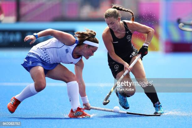 Rebecca Condie of Scotland and Shiloh Gloyn of New Zealand compete for the ball during the Pool B Hockey match between New Zealand and Scotland on...