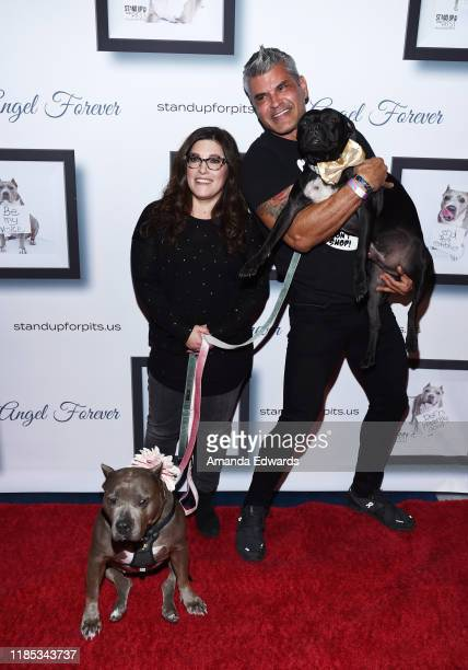 Rebecca Corry and Mike Ruiz arrive with Sally and Todd the Pitbulls at the 9th Annual Stand Up For Pits event hosted by Kaley Cuoco at The Mayan on...