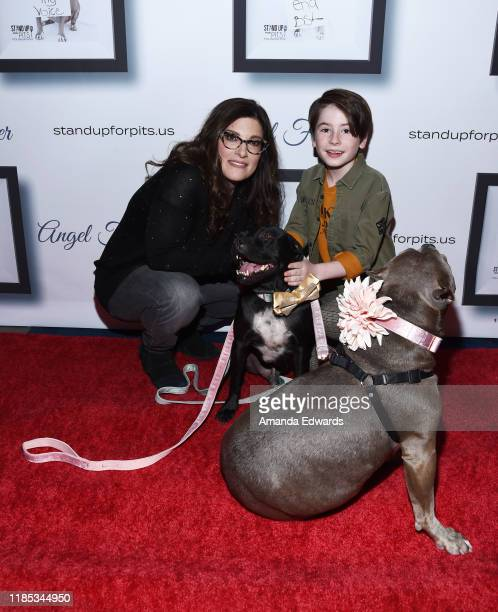 Rebecca Corry and Paxton Booth arrive with Sally and Todd the Pitbulls at the 9th Annual Stand Up For Pits event hosted by Kaley Cuoco at The Mayan...