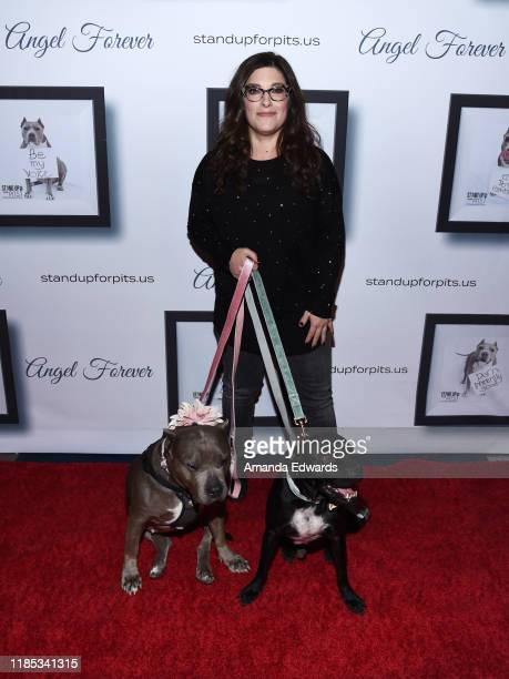 Rebecca Corry arrives with Sally and Todd the Pitbulls at the 9th Annual Stand Up For Pits event hosted by Kaley Cuoco at The Mayan on November 03,...