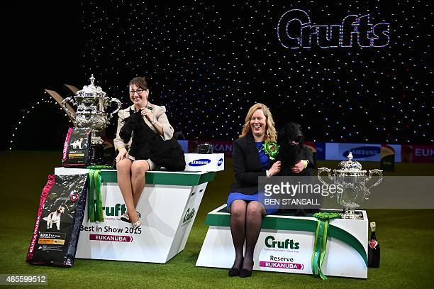 Rebecca Cross with the Scottish Terrier 'Knopa' bred in US with Russian ownership from the Terrier Group and winner of the Best in Show category and...