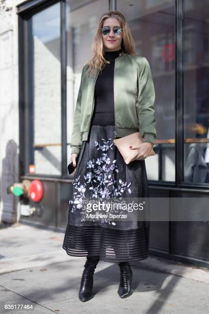 Rebecca Daly is seen attending SHOW during New York Fashion Week wearing a green jacket with black sweater and black and white skirt on February 13...