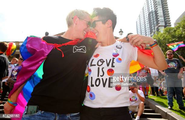 Rebecca Davies and her partner Paula Van Bruggen celebrate in the crowd as the result is announced during the Official Melbourne Postal Survey Result...