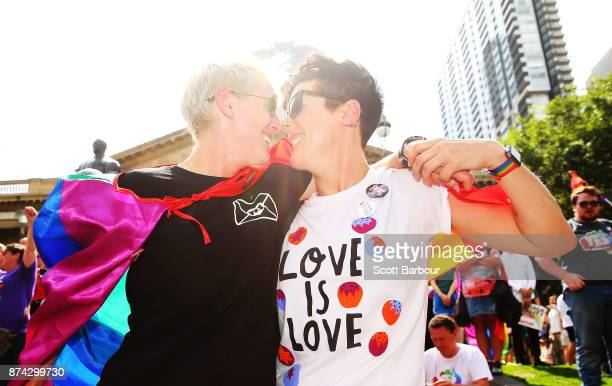 Rebecca Davies and her partner Paula Van Bruggen kiss as they celebrate in the crowd as the result is announced during the Official Melbourne Postal...
