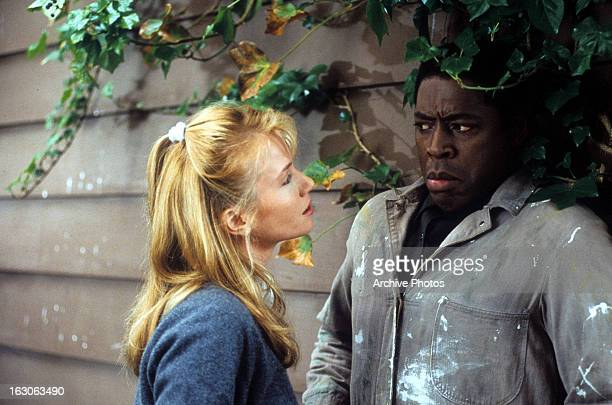 Rebecca De Mornay approaches Ernie Hudson in a scene from the film 'The Hand That Rocks the Cradle' 1992
