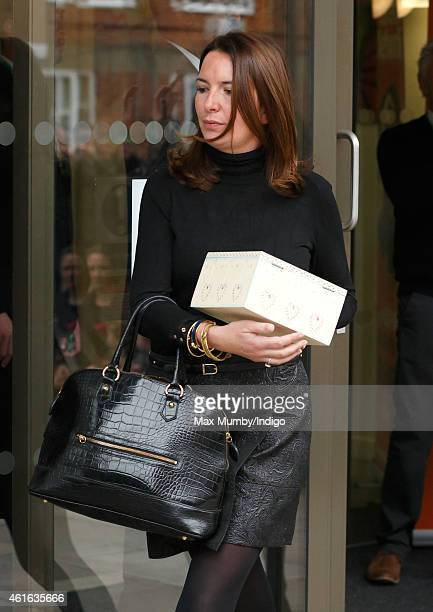 Rebecca Deacon carries a 'memory box' presented to Catherine Duchess of Cambridge containing stories and poems written by children brought up in...