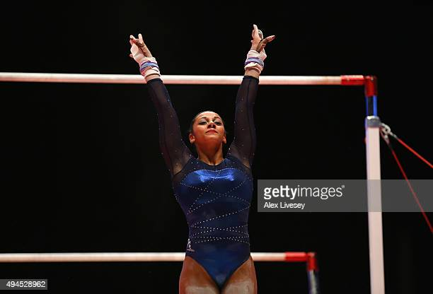 Rebecca Downie of Great Britain competes in the Uneven Bars during Day 5 of the 2015 World Artistic Gymnastics Championships at The SSE Hydro on...