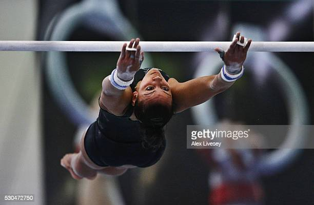 Rebecca Downie of the British Gymnastics Team trains on the Uneven Bars during a training session at Lilleshall National Sports Centre on April 29...