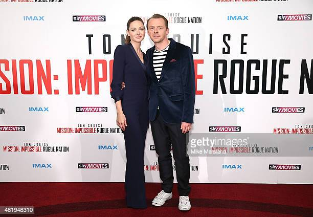 Rebecca Ferguson and Simon Pegg attend the UK Fan Screening of 'Mission: Impossible - Rogue Nation' at the IMAX Waterloo on July 25, 2015 in London,...