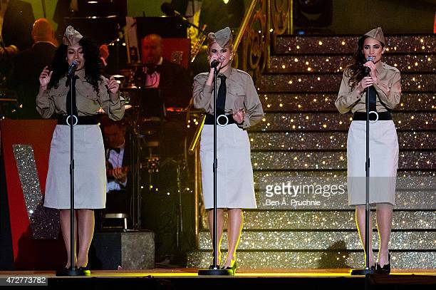 Rebecca Ferguson Pixie Lott and Laura Wright perform during a concert on the 70th anniversary of VE Day at Horse Guards Parade on May 9 2015 in...