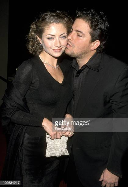 Rebecca Gayheart and Brett Ratner during The 40th Annual GRAMMY Awards Arista Records PreParty Hosted by Clive Davis at Plaza Hotel in New York City...
