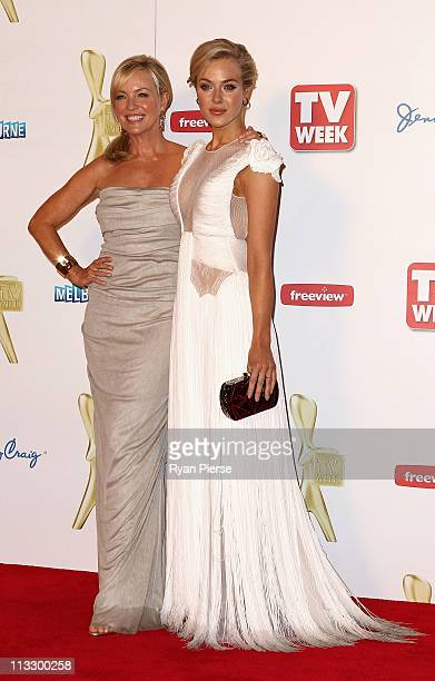 Rebecca Gibney and Jessica Marais arrive on the red carpet ahead of the 2011 Logie Awards at Crown Palladium on May 1 2011 in Melbourne Australia