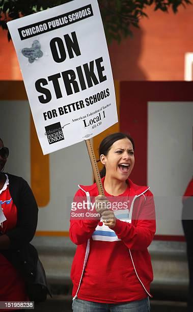 Rebecca Gonzalez a preschool teacher pickets outside Burr Elementary School on September 13 2012 in Chicago Illinois More than 26000 teachers and...