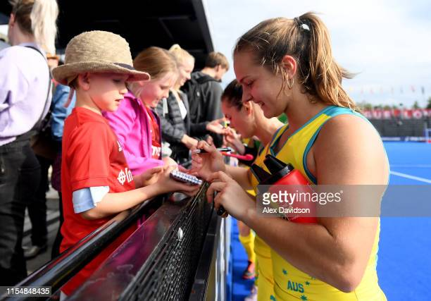 Rebecca Greiner of Australia signs autographs during the Women's FIH Field Hockey Pro League match between Great Britain and Australia at Lee Valley...