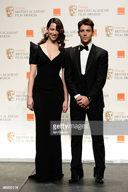 Rebecca Hall and Jonathan Rhys Myers pose in the awards room during Orange British Academy Film Awards 2010 at the Royal Opera House on February 21...