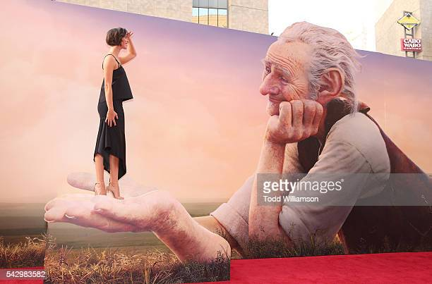 """Rebecca Hall poses with the BFG at the premiere Of Disney's """"The BFG"""" at the El Capitan Theatre on June 21, 2016 in Hollywood, California."""