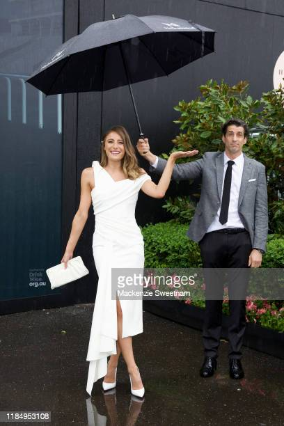 Rebecca Harding and Andy Lee attend Derby Day at Flemington Racecourse on November 02 2019 in Melbourne Australia