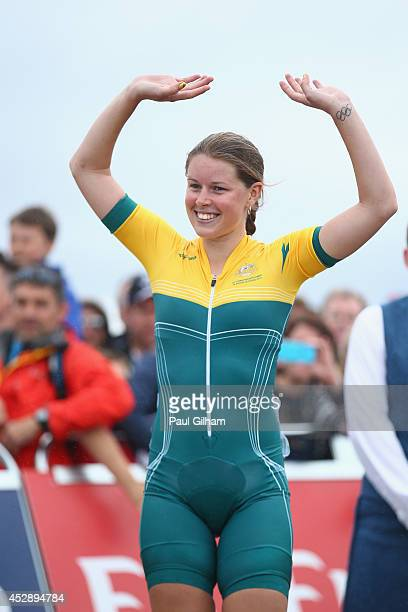 Rebecca Henderson of Australia celebrates winning a bronze medal in the Women's Cross Country Mountain Biking at Cathkin Braes Mountain Bike Trails...