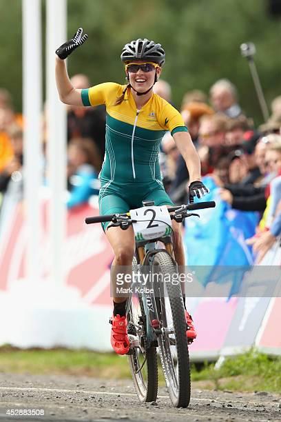 Rebecca Henderson of Australia celebrates winning bronze in the Women's Crosscountry Mountain Biking at Cathkin Braes Mountain Bike Trails during day...