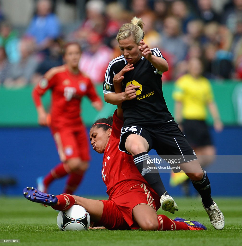 Rebecca Huyleur of Muenchen is challenged by Svenja Huth of Frankfurt during the Women's DFB Cup Final between 1. FFC Frankfurt and Bayer Muenchen at RheinEnergie Stadium on May 12, 2012 in Cologne, Germany.