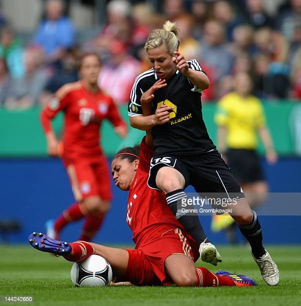 Rebecca Huyleur of Muenchen is challenged by Svenja Huth of Frankfurt during the Women's DFB Cup Final between 1 FFC Frankfurt and Bayer Muenchen at...