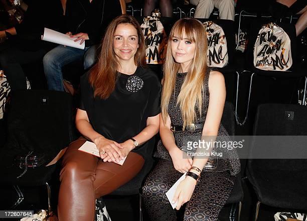 Rebecca Immanuel and Kristina Bazan attend the Schumacher Show during MercedesBenz Fashion Week Spring/Summer 2014 at Brandenburg Gate on July 4 2013...