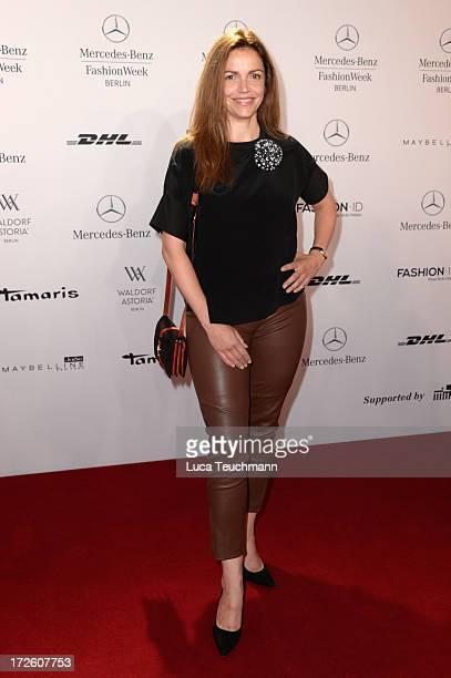 Rebecca Immanuel attends the Schumacher Show during MercedesBenz Fashion Week Spring/Summer 2014 at the Brandenburg Gate on July 4 2013 in Berlin...