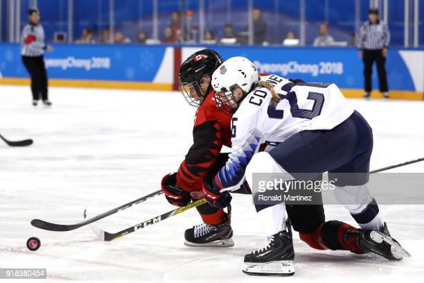 Rebecca Johnston of Canada and Kendall Coyne of the United States go for the puck in the first period during the Women's Ice Hockey Preliminary Round...