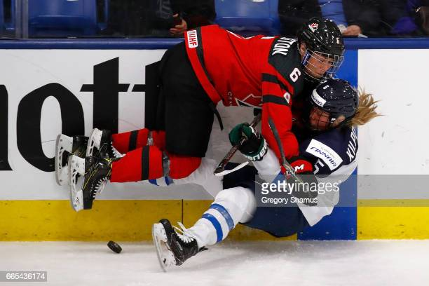 Rebecca Johnston of Canada battles for the puck with Anna Kilponen of Finland in the second period during a semifinal game at the 2017 IIHF Womans...
