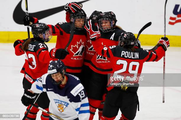 Rebecca Johnston of Canada celebrates a second period goal with Erin Ambrose Brianne Jenner Natalie Spooner and MariePhilip Poulin behind Tanja...