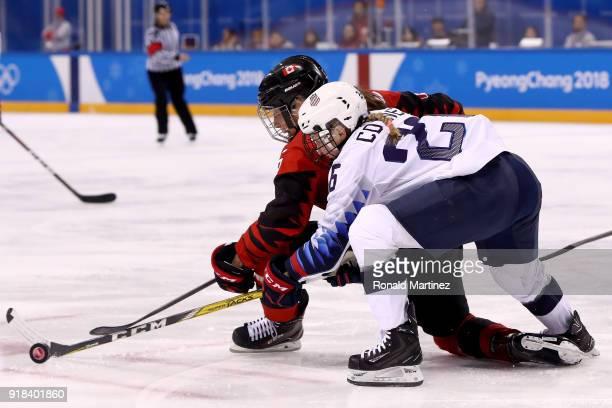 Rebecca Johnston of Canada handles the puck against Kendall Coyne of the United States during the Women's Ice Hockey Preliminary Round Group A game...
