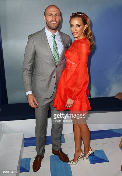 Rebecca Judd and Chris Judd pose at the Lavazza Marquee on Melbourne Cup Day at Flemington Racecourse on November 3 2015 in Melbourne Australia