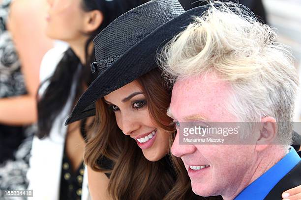 Rebecca Judd and Philip Treacy enjoy the Fashions on the Field women's racewear competiton at Flemington Racecourse on November 3 2012 in Melbourne...