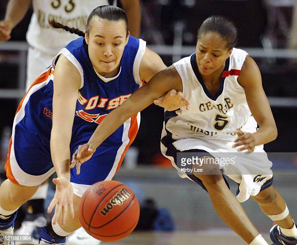 Rebecca Kepilino of Boise State left and Kimberly Beck of George Washington dive for loose ball during NCAA Women's Basketball Tournament firstround...