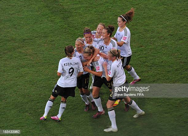 Rebecca Knaak of Germany celebrates scoring the winning goal in injury time with her team mates during the FIFA U17 Women's World Cup 2012...