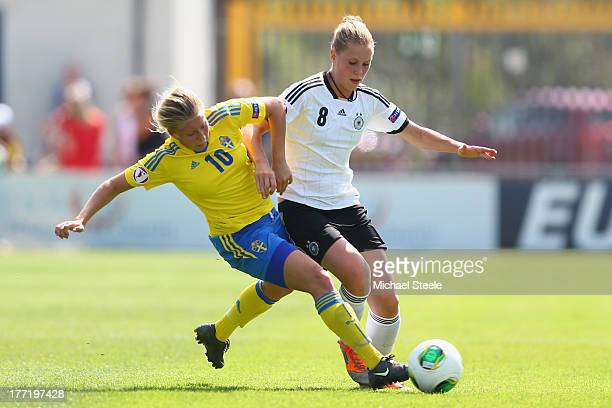 Rebecca Knaak of Germany U19 women is challenged by Fanny Anderson of Sweden U19 women during the European Women's Under19 Championship match between...