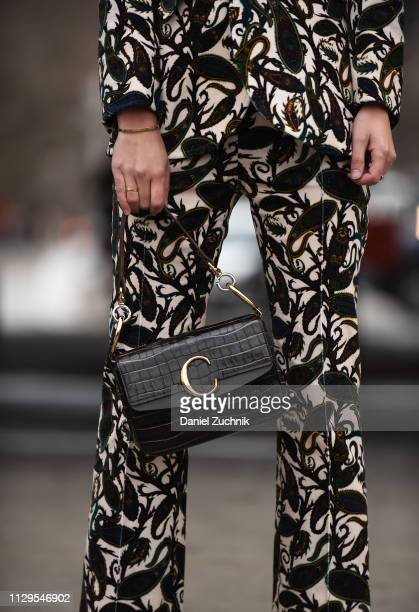 Rebecca Laurey is seen wearing a Boss suit and brown bag outside the Boss show during New York Fashion Week: Fall/Winter 2019 on February 13, 2019 in...