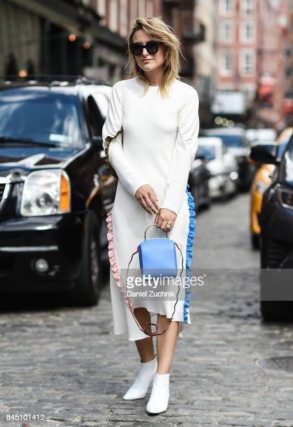 Rebecca Laurey is seen wearing a Tibi dress Roksanda bag and Gestuz shoes outside the Tibi show during New York Fashion Week Women's S/S 2018 on...