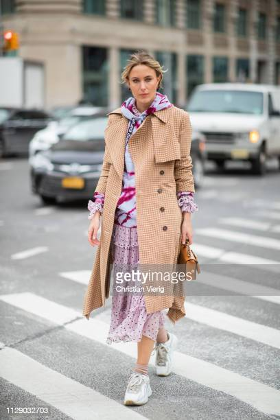 Rebecca Laurey is seen wearing brown coat pink dress hoody outside Zimmermann during New York Fashion Week Autumn Winter 2019 on February 11 2019 in...